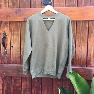 Olive green triangle cut out sweatshirt.